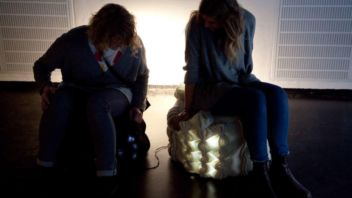 Linked together: The students have used electronic fabric to link people together. If you sit down on one stool the other one lights up – and there you have your conversation.